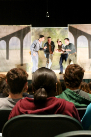 students watch v c u actors on stage