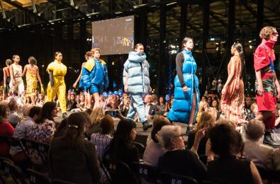 fashion and design students walking down runway at fashion show
