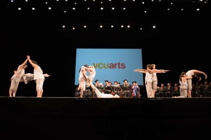 v c u arts students spelling out arts in dance at commencement