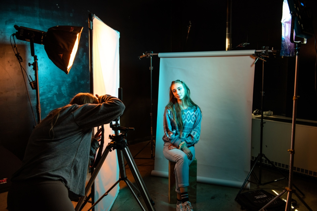 students shooting photos in a studio