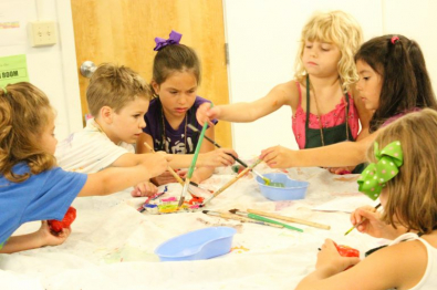 children working on painting project