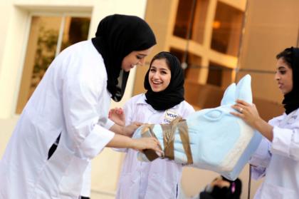 three students building a sculpture at the v c u arts qatar campus