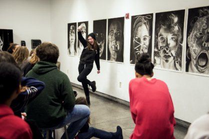 First-year students in the Art Foundation program present their double portraits in Ryan Lauterio's drawing class.