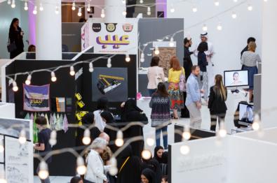 many people walking through art exhibit at the v c u arts qatar campus