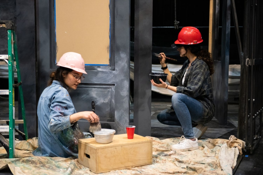students painting a theatre set