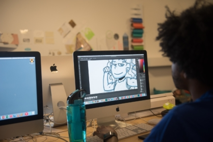 student working on illustration on computer screen