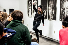 art foundation student cheering at exhibition
