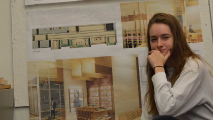 Ellen Shelly in front of a wall of interior design mockups
