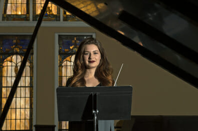 Portrait of Lida Bourhill holding a conducting baton