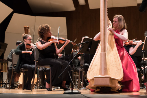 harpist performs with orchestra