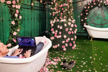 sam in bath tub on set with greenscreen