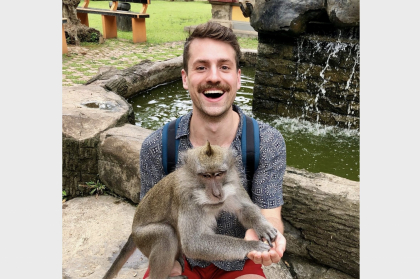 matt smiling and holding monkey