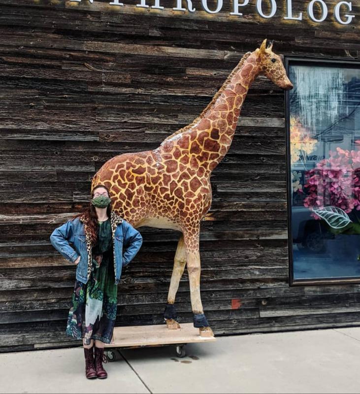Julia standing next to a model giraffe